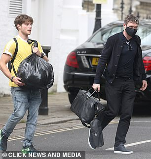 Outing: Richard carried a large black carrier bag
