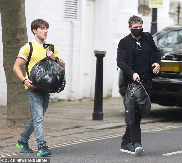 Relaxed look:Froy, meanwhile, kept things casual as he teamed a yellow shirt with light-wash denim jeans and colourful trainers