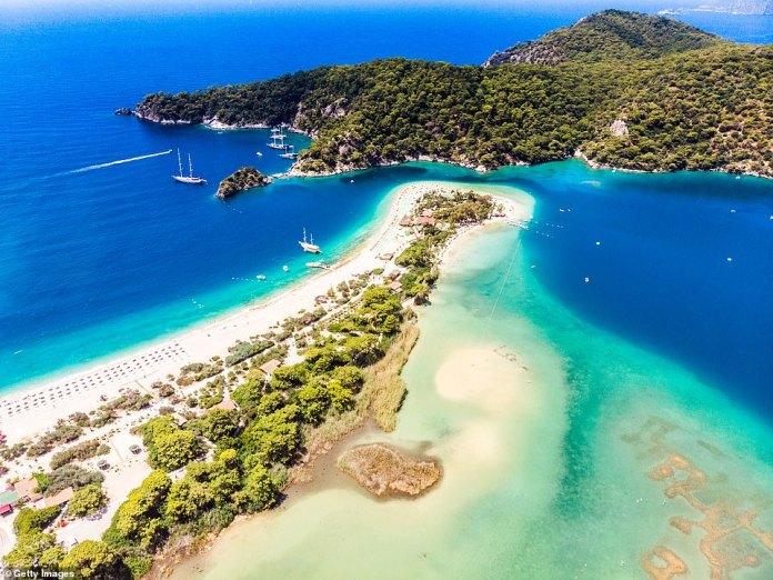 The lagoon resort of Oludeniz, where the beach is the landing spot for paragliders, who descend fromthe peak of Babadaği