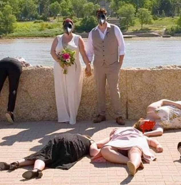 'Tone deaf': In the photos, the bride and groom are seen posing hand-in-hand while wearing bird-shaped face masks, while their guests are sprawled on the floor
