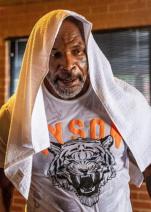 Mike Tyson (pictured) and Jones did not meet during their boxing heydays and fans are salivating at the two men going head to head.
