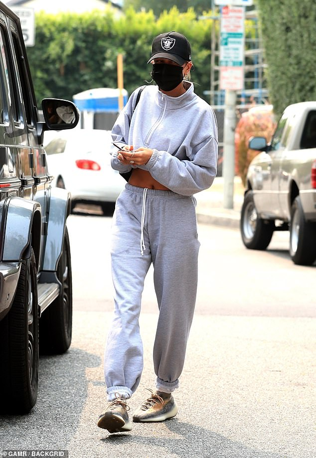 Making her way:The blonde beauty paired her top with matching drawstring sweatpants