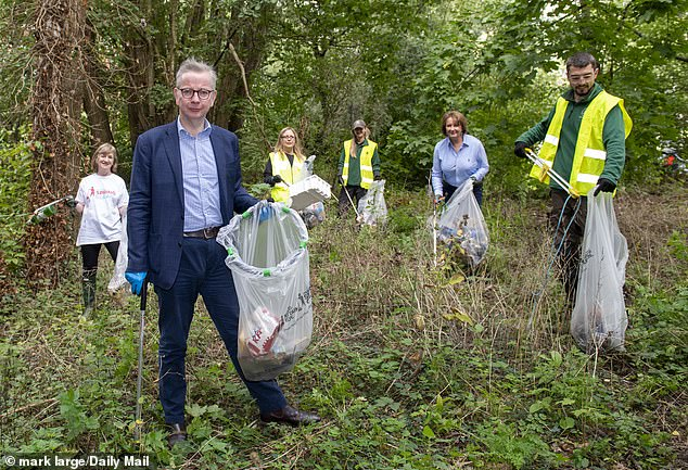 MIchael Gove was among those who joined volunteers around the country picking up litter