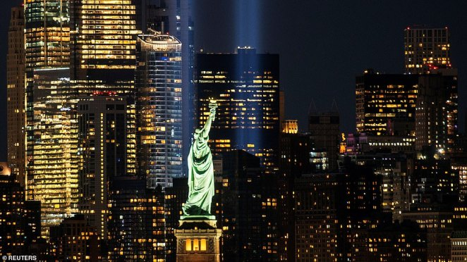 The Statue of Liberty is seen as the Tribute in Light shines in downtown Manhattan to commemorate the 19th anniversary of the September 11, 2001 attacks on the World Trade Center at the 9/11 Memorial & Museum