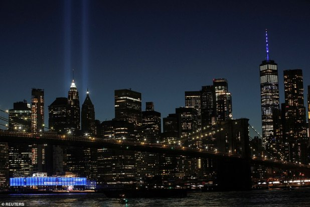 Lower Manhattan buildings are fully impressed with tributes in light towing above the city's iconic skyline