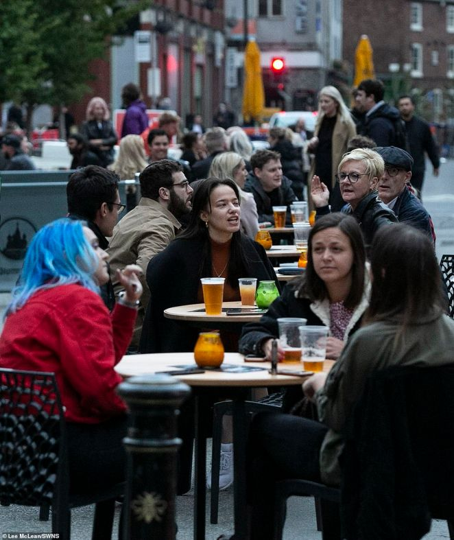 Elsewhere in Manchester, groups sat together as they enjoyed a pint outside a bar in the city centre last night