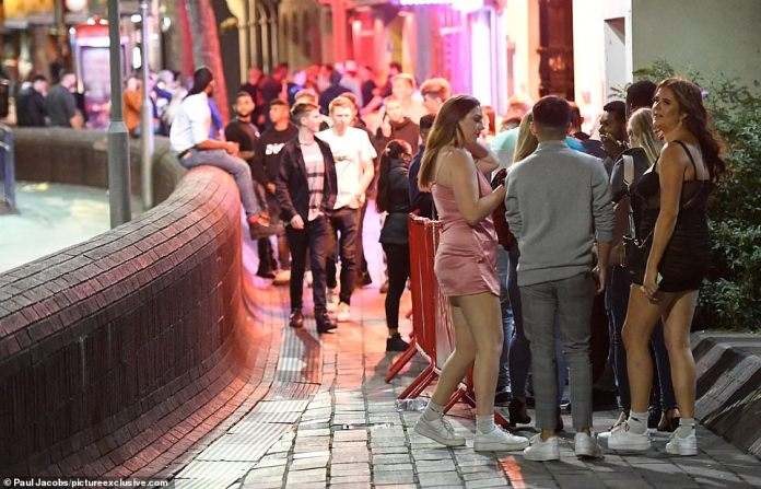 Elsewhere in the city, dozens of revellers were seen standing closely together as they waited to enter a busy club on Friday