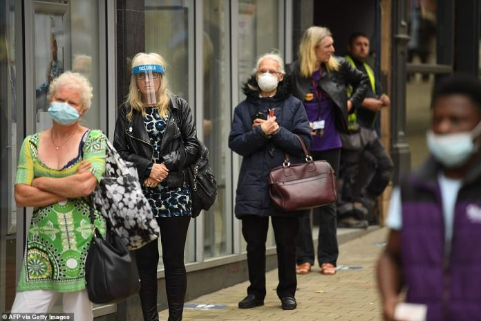 Last week, infections increased 92 per cent among those in their 50s, 72 per cent among those in their 60s, and 44 per cent among those in their 80s and older (pictured: people wearing face masks and visors in Leeds)