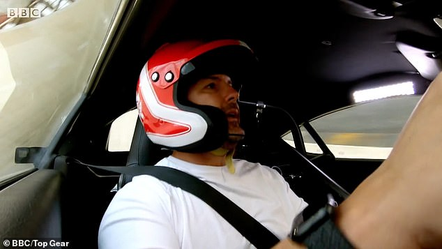 Danger:It then shows the Take Me Out star zooming around a motordrome in an old insurance write-off, a Porsche Cayman, as he warns: 'This does not feel good!'