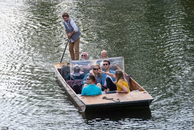People go sightseeing on the River Cam in Cambridge on Saturday afternoon as they enjoy the warm end of summer weather