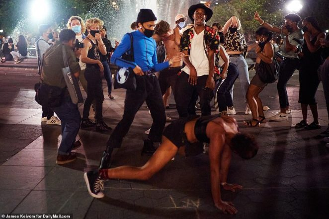 A partygoer twerks in Washington Square Park on Friday, September 11 in New York City