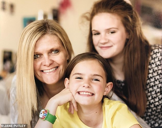 'Like having a tooth out': Jane Putley, now cancer-free, with her daughters Izzy and Lucy.The mother-of-two was diagnosed in February 2018, after a mammogram