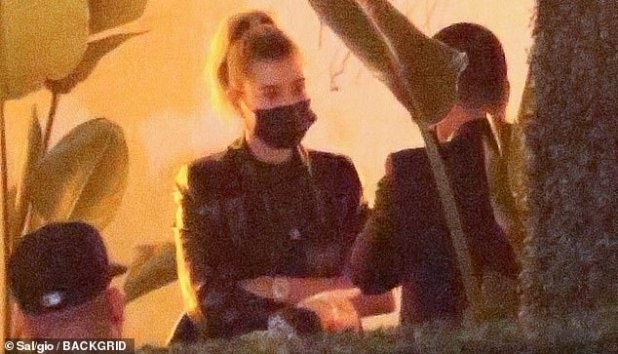 Safe distance: Hailey enjoyed a socially perverse chat with a pal as the two put on masks in Delilah