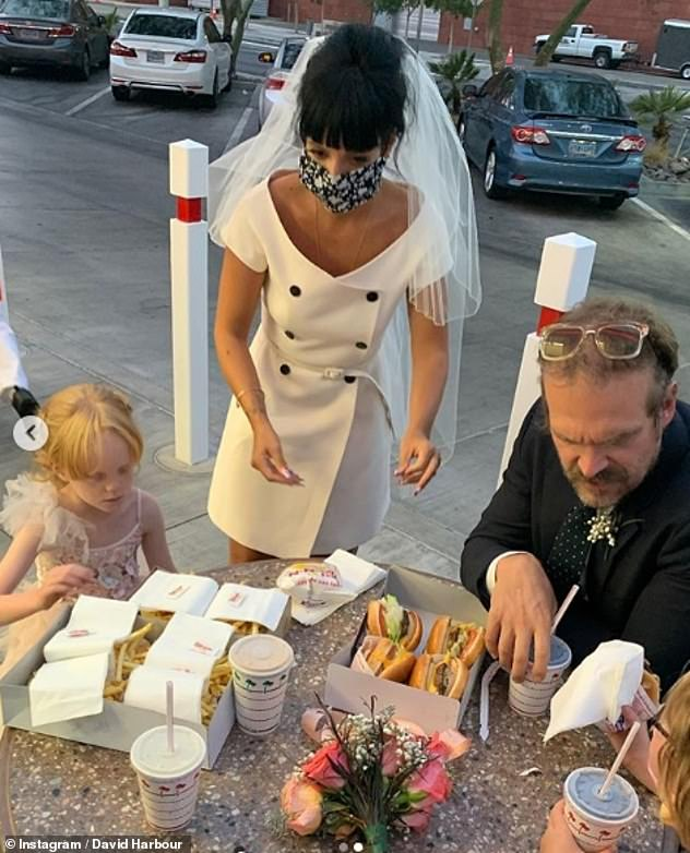 Wedding bells: Lily and David tied the knot before enjoying a take-out dinner from the In-N-Out fast food chain with daughters Ethel and Marnie