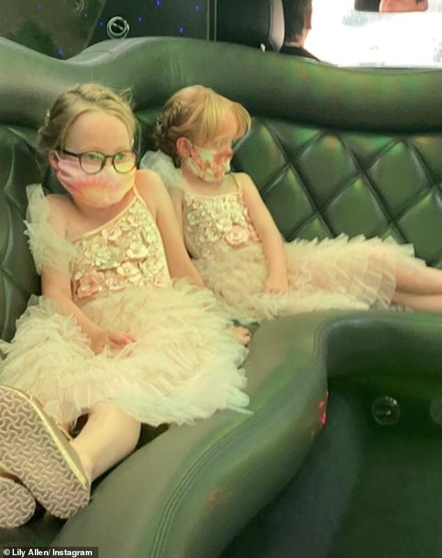 Sweet: Another invisible snap featured daughters Ethel, eight, and Marnie, seven, relaxing in a limo with face masks on