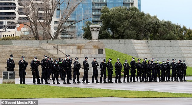 A line of police officers is seen outside the Shrine of Remembrance in Melbourne on Saturday morning. Thousands had vowed to attend the protest