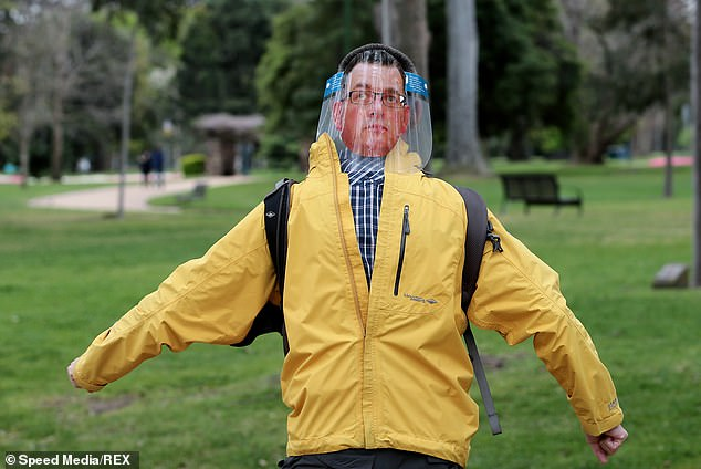 Meanwhile a man with a picture of Premier Daniel Andrews stuck to the back of his face shield paraded through the protest
