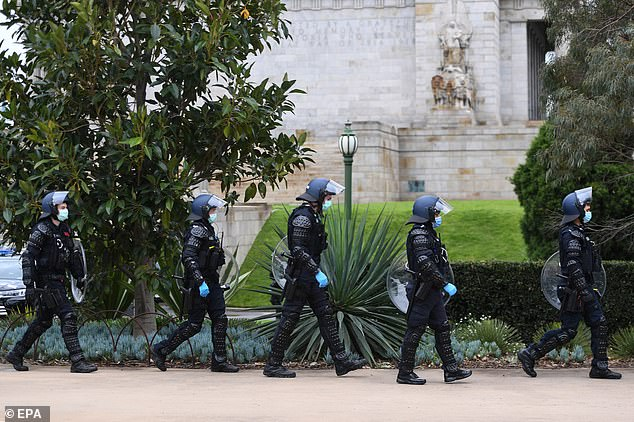 Dramatic scenes unfolded in Melbourne on Saturday as police in riot gear wandered through the streets preparing to detain any protesters