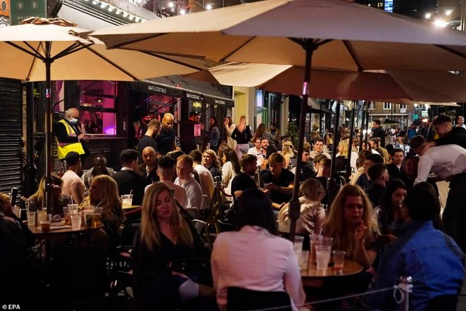 Members of the public spend a night out in Central London, Britain tonight. The British government is due to implement new restrictions banning gatherings of six people from Monday