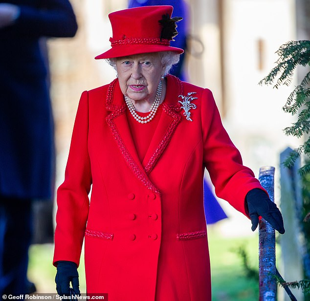 Festive tradition: The Queen in red for the Christmas Day service at Sandringham last year. The Monarch will be unlikely to walk to church in public on Christmas Day