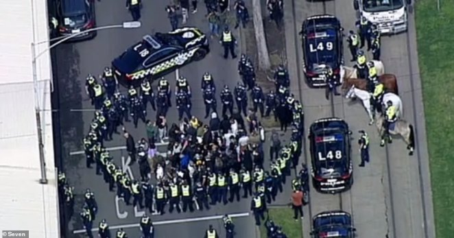 Tensions between police and protesters escalated about 11.45am on Sunday when about 50 people were cornered by police on Peel Street