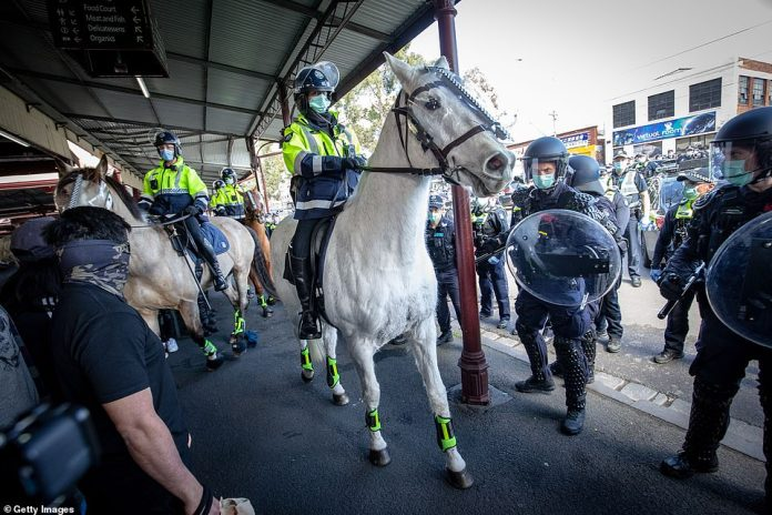 Mounted police used their horses to break through heavy congestion, moving people along in the process