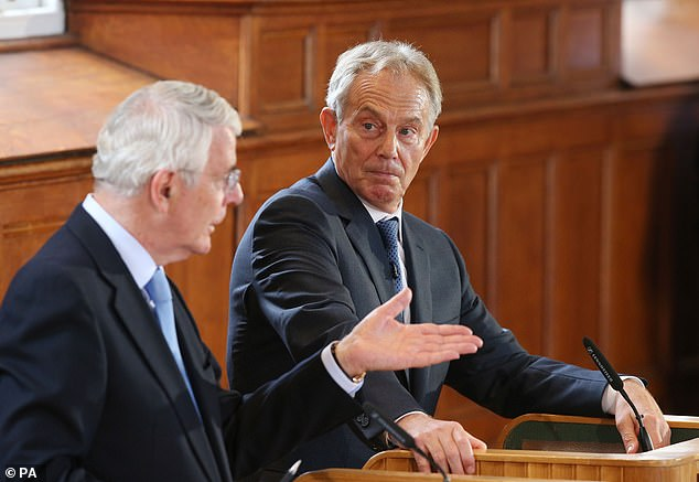 Tony Blair and Sir John Major, pictured in Northern Ireland ahead of the EU referendum in 2016, today joined forces to savage Boris Johnson's Brexit plans