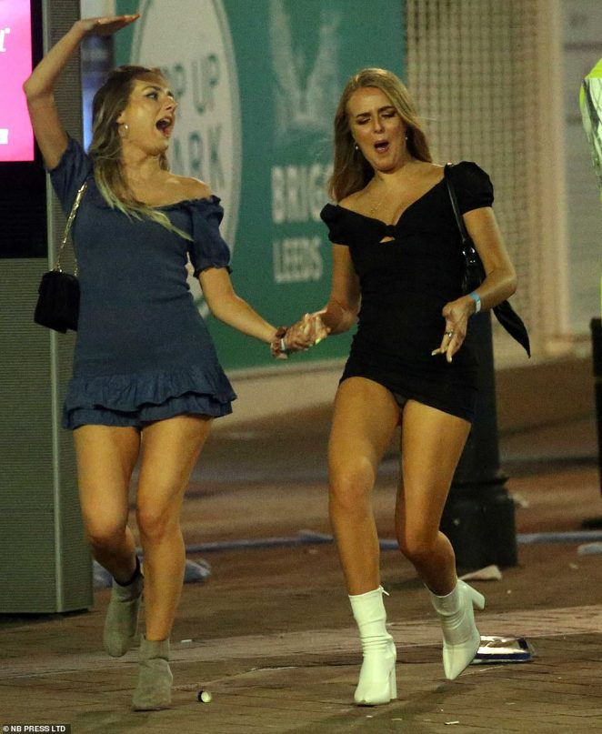 LEEDS: Two woman walk through the streets of Leeds on Satudray night as people flocked to bars ahead of new social distancing rules