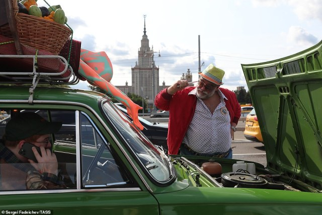 A Lada owner showed off his car during the rally before showing off the cars impressive motor and performing tweaks on the interior