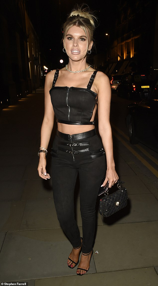 Toned: Blonde beauty Hayley, 21, opted for a black cropped top and matching black pants with leather details