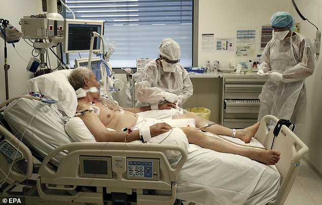 Doctors and nurses wearing protective gear take care of a patient suffering from the coronavirus disease at the resuscitation intensive care unit (ICU) of the Hopital Europeen hospital in Marseille, France