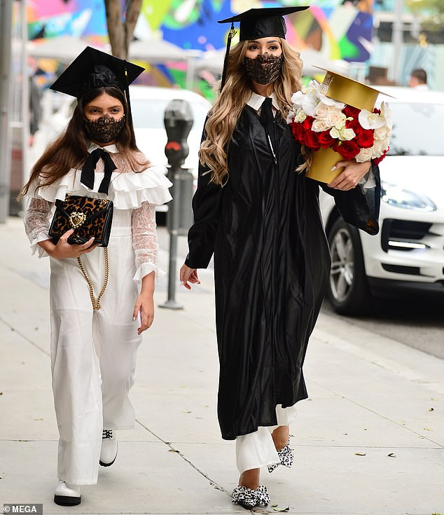 Twinning:For her special day Farrah rocked a white jumpsuit with a collar and lace detailing under her scholarly gown as she matched with her daughter