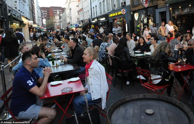 LONDON: Groups of people met and sat around tables in London's Soho district to enjoy a drink in the streets of the popular nightlife hot-spot