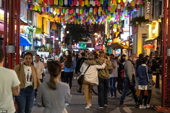 LONDON: Revellers walk through London's Chinatown in the city's West End as people enjoy one last night of freedom in the capital