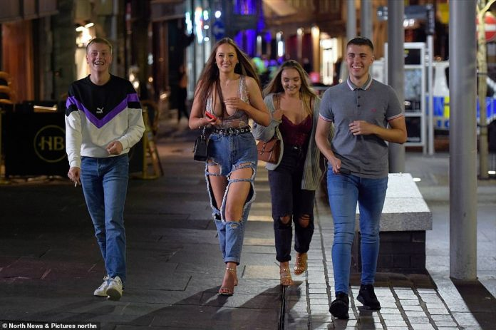 NEWCASTLE: Revellers enjoy a night out on the town on Friday night as the government prepares to bring in new rules limiting the number of people in groups to six
