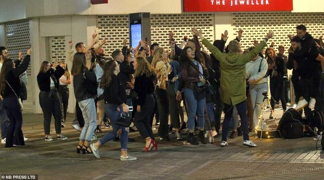 LEEDS: In Leeds a busker attracted a group of around 50 people who celebrated and cheered as the musician played in the street
