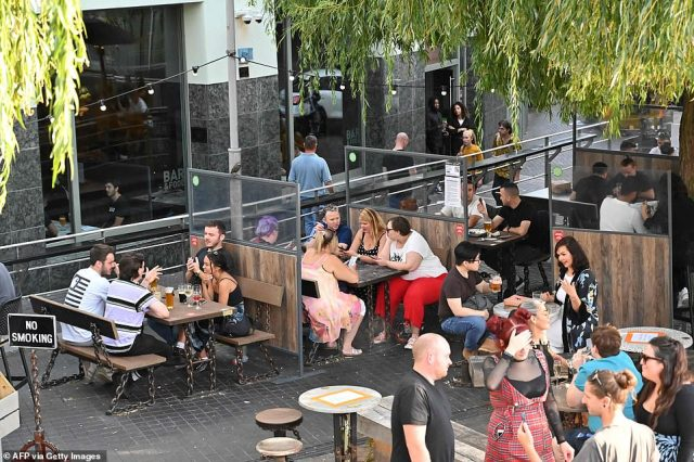 In Camden, weekend revellers packed the bars and pubs, with groups separated by perspex panels as they met up on the last day before new restrictions