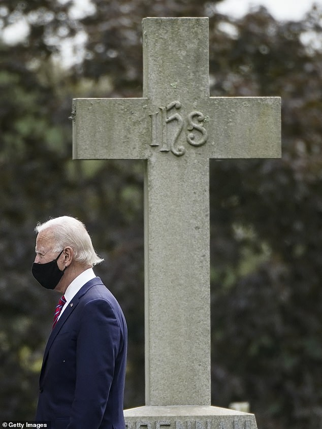 Biden pictured leaving the church ceremony and site on Sunday afternoon