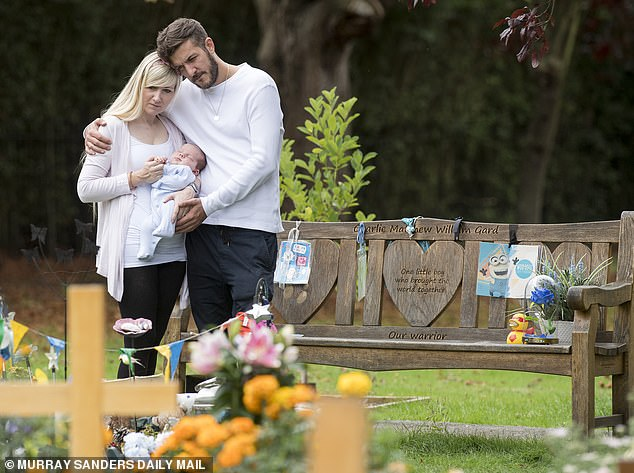 """Connie Yates and Chris Gard bring their newborn son Oliver to his late brother's grave.Connie said: 'I was cuddling him and saying, """"This is your big brother Charlie."""""""