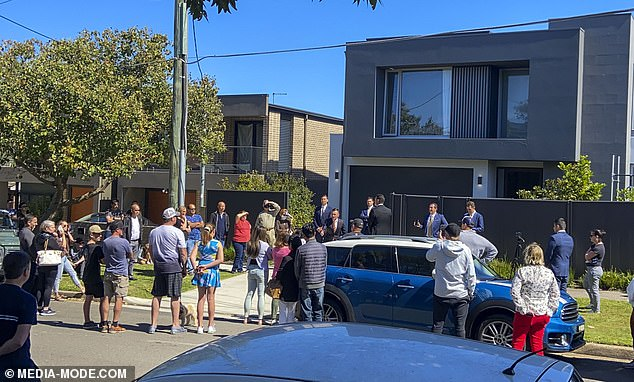 New normal: The COVID-friendly auction saw potential buyers socially distancing along the street - a scene that would no doubt have infuriated Pete, who thinks the pandemic is a hoax
