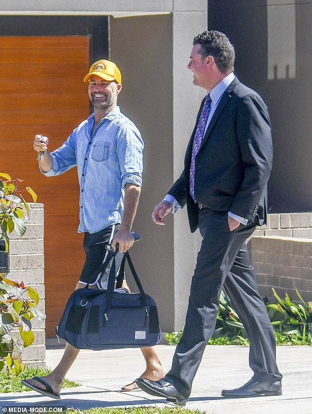Going, going, gone! Conspiracy theorist Pete Evans (left) beamed while on a stroll with his real estate agent just moments before selling his Malabar mansion at auction for $3.5million