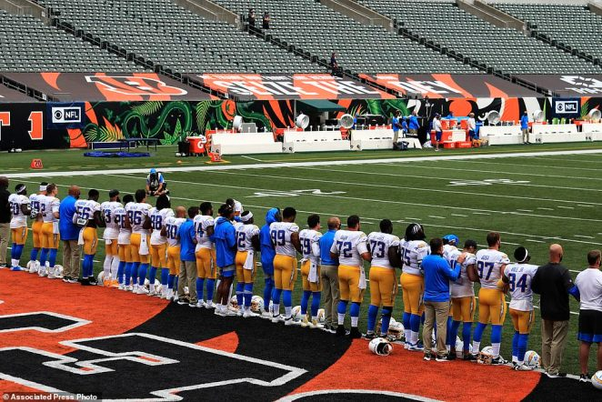 The Cincinnati Bengals and the Los Angeles Chargers linked arms and stood for a moment in a stand against racial inequality
