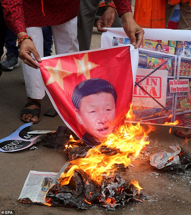Activists burn a poster of Chinese President Xi Jinping in India in June. US Deputy Secretary of State said the organisation could act as a bulwark against 'a potential challenge from China'