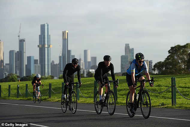 Daily exercise: Cyclists riding at Albert Park in Melbourne during the city's strict lockdown