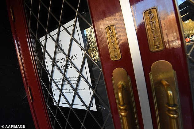 Signage is seen in a window of a closed pub in Melbourne on Thursday, September 10