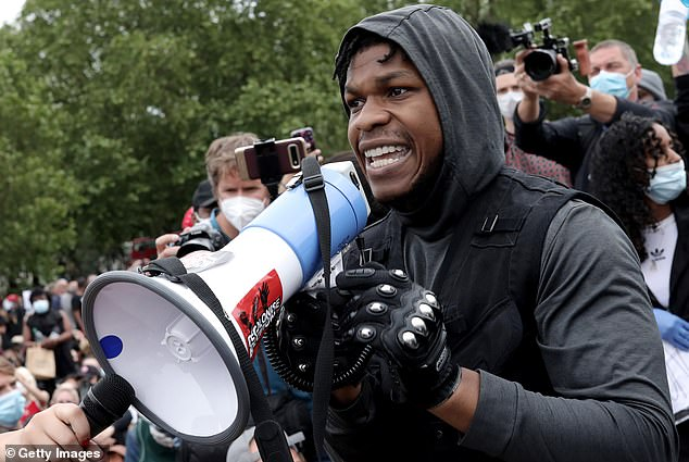 Jo Malone London has apologised to John Boyega, pictured at a BLM protest in London in June, for cutting him out of an advert when it was remade for the Chinese market