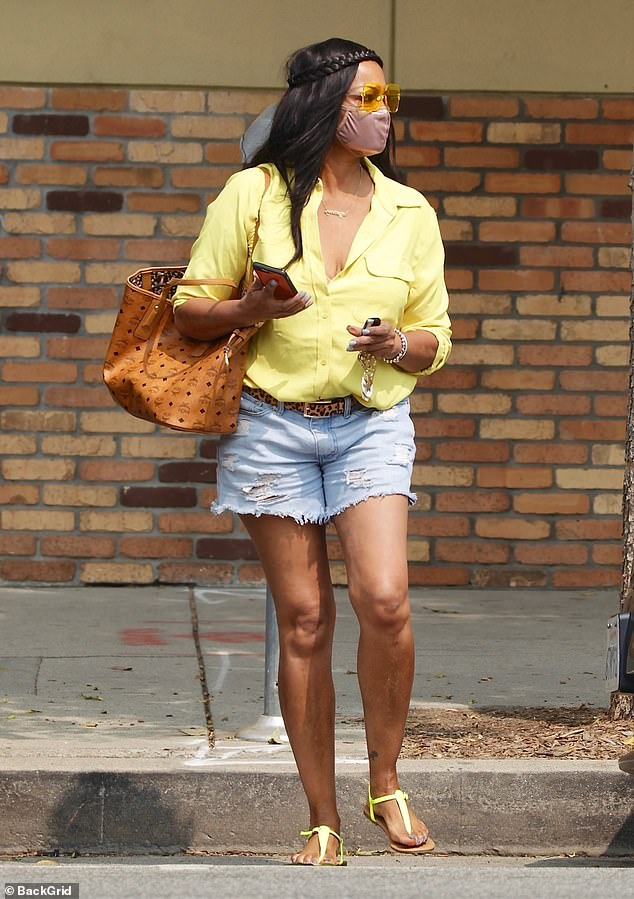 Leggy look: Real Housewives Of Beverly Hills star Garcelle Beauvais stepped out on Sunday in a pair of distressed Daisy Dukes and a lemon yellow blouse to get her nails done at a salon
