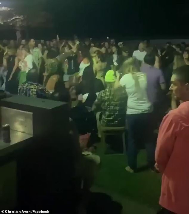 The co-owner of a popular burger chain has slammed a video showing partygoers dancing shoulder to shoulder while his restaurant is crippled by COVID-19 social distancing rules