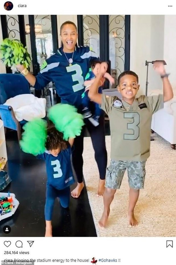 '#GoHawks': Sierra shared this picture on Sunday and showed her and her children cheering Russell Wilson on game day.  She held Baby Win as Siana, three and Future, six, made the jump