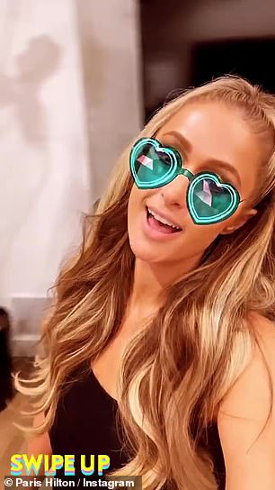 Heart eyes: Shortly after, she posted another video without the robe, as she paced around the house with a heart-eye sunglasses face filter